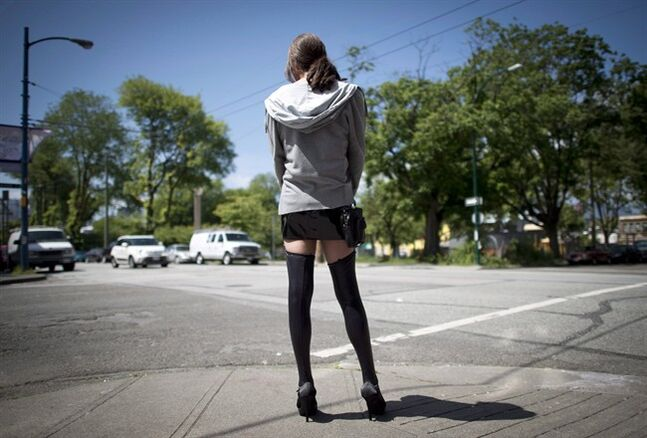 A sex trade worker is pictured in downtown Vancouver, B.C., Wednesday, June, 3, 2014. New amendments to the government's prostitution bill will give it a better chance of withstanding a constitutional court challenge, says a leading Conservative on the House of Commons justice committee. THE CANADIAN PRESS/Jonathan Hayward