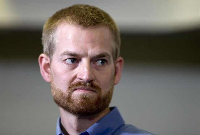 Ebola victim Dr. Kent Brantly looks on during a news conference after being released from Emory University Hospital, Thursday, Aug. 21, 2014, in Atlanta. Another American aid worker, Nancy Writebol, who was also infected with the Ebola virus, was released from the hospital Tuesday. (AP Photo/John Bazemore)