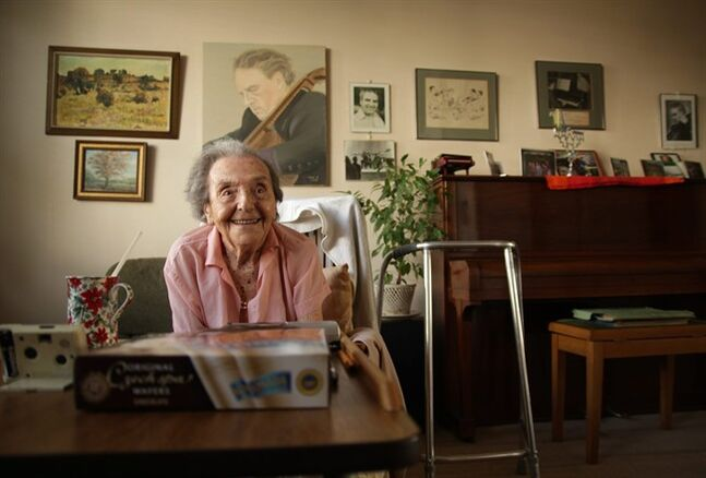 EDITORS AND LIBRARIANS PLEASE ELIMINATE THIS IMAGE FROM YOUR SYSTEMS AS PERMISSION FOR THE ASSOCIATED PRESS TO USE THIS IMAGE HAS BEEN WITHDRAWN BY THE COPYRIGHT HOLDER Photo dated July 2010 made available by the makers of the Oscar nominated documentary The Lady in Number 6, in which she tells her story, of Alice Herz-Sommer, believed to be the oldest-known survivor of the Holocaust, who died in London on Sunday morning at the age of 110. Herz-Sommer's devotion to the piano and to her son sustained her through two years in a Nazi prison camp. (AP Photo/The Lady in Number 6, Bunbury Films)