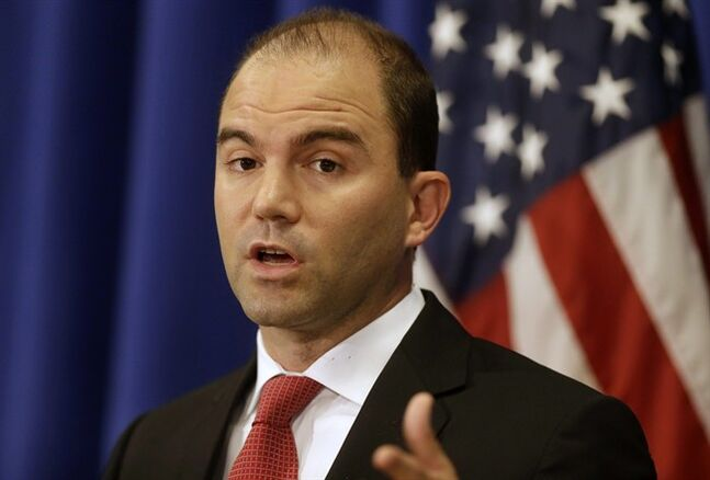 Deputy National Security Adviser for Strategic Communications and Speechwriting Ben Rhodes speaks to reporters during a press briefing, Friday, Aug. 22, 2014, in Edgartown, Mass., on the island of Martha's Vineyard. Rhodes spoke on issues concerning the situation in Iraq and Ukraine. (AP Photo/Steven Senne)