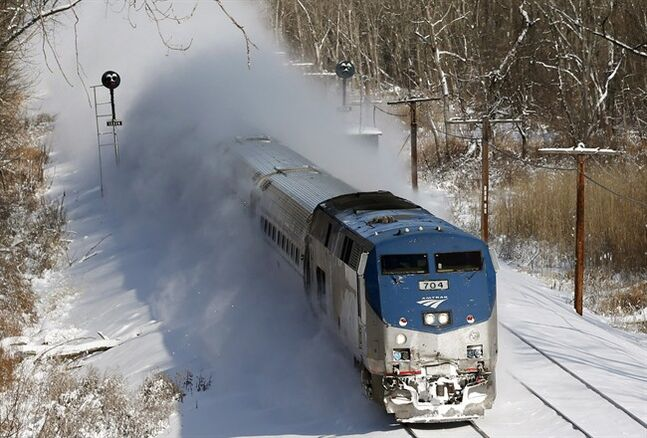 An Amtrak train kicks up fresh snow Jan. 3, 2014, in Schodack Landing, N.Y. THE CANADIAN PRESS/AP, Mike Groll