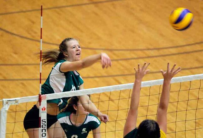 Left side Kristine Ward hammers a kill for the Neelin Spartans during their semifinal victory over the Miles Mac Buckeyes on Nov. 27.