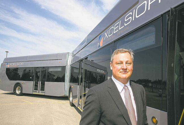 Paul Soubry, president and CEO of New Flyer, which has seen a surge in new bus orders this year, stands in front of a bendy-bus.