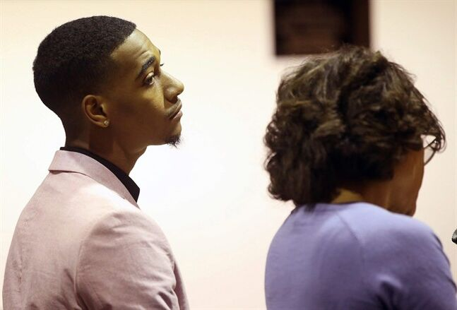 Rapper Lil Za, left, stands with his Attorney, Shawn Holley, during during his arraignment in Los Angeles Superior Court on Wednesday, April 30, 2014. Lil Za, who's real name Xavier Smith, pleaded no contest to felony possession of ecstasy, and was sentenced to three years of probation and a drug treatment program in a case that was filed after he was arrested during a search of Justin Bieber's mansion in January 2014. (AP Photo/Nick Ut)