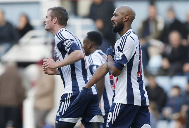 FILE - This Saturday Dec. 28, 2013 file photo shows West Bromwich Albion's Nicolas Anelka, right, as he gestures to celebrate his goal against West Ham United during their English Premier League soccer match at Upton Park, London. The English Football Association has banned Nicolas Anelka for five games after finding the West Bromwich Albion striker guilty of causing racial offense with a goal celebration deemed anti-Semitic. Anelka had denied that his use of the gesture, which is known in France as a