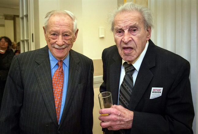 In this photo taken March 4, 2014, Berlin, Germany, Edgar Krasa, right, a 93-year-old survivor of Nazi concentration camps meets with W. Michael Blumenthal, former U.S. Treasury Secretary who now heads the Jewish Museum in the German capital. The two were attending a performance of a mass to commemorate the victims of Nazi terror at the Terezin concentration camp. Edgar Krasa took part in one of the ennobling acts of the Holocaust. He didn't take up arms in a ghetto insurrection, or fight in the Jewish underground. Instead, he and several hundred fellow concentration camp inmates defied the Nazis through music. (AP Photo/Svea Pietschmann-Judisches Museum Berlin)