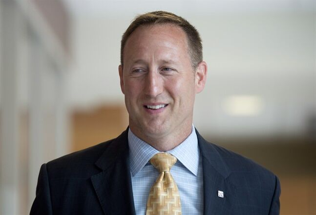 Justice Minister Peter MacKay arrives at a Commons Justice committee meeting Monday July 7, 2014 in Ottawa. MacKay was the first witness up at the committee hearing witnesses. THE CANADIAN PRESS/Adrian Wyld