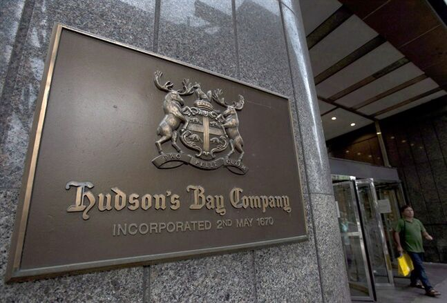 "A Hudson's Bay Co. store sign is shown at its Toronto flagship store on July 29, 2013. HBC is selling two properties that house its Toronto flagship store and executive offices to Cadillac Fairview �€"" the company that operates the neighboring Toronto Eaton Centre. THE CANADIAN PRESS/Nathan Denette"