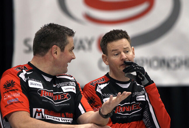 Third Allan Lyburn (left) and skip Rob Fowler discuss a shot during this year's provincial men's curling championship in Winnipeg.