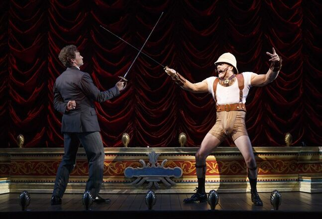 This theater image released by The O+M Company shows Bryce Pinkham, left, and Jefferson Mays during a performance of