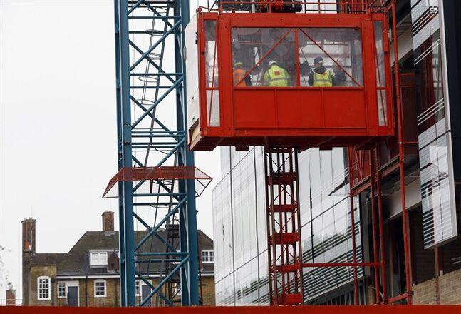 Workers are transported on a construction site in London on Oct. 25, 2012. THE CANADIAN PRESS/AP, Kirsty Wigglesworth