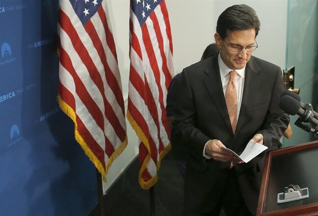 House Majority Leader Eric Cantor of Va. takes the podium to speak to reporters on Capitol Hill in Washington, Wednesday, June 11, 2014, after a House Republican caucus meeting. Repudiated at the polls, House Majority Leader Eric Cantor intends to resign his leadership post at the end of next month, officials said Wednesday, clearing the way for a potentially disruptive Republican shake-up just before midterm elections with control of Congress at stake. (AP Photo/Charles Dharapak)