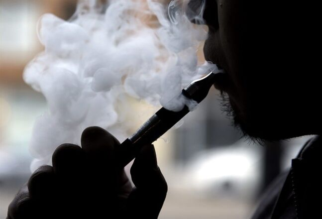 FILE - In this April 23, 2014, file photo, an electronic cigarette is demonstrated in Chicago. In a surprising new policy statement, the American Heart Association backs electronic cigarettes as a last resort to help smokers quit. (AP Photo/Nam Y. Huh, File)