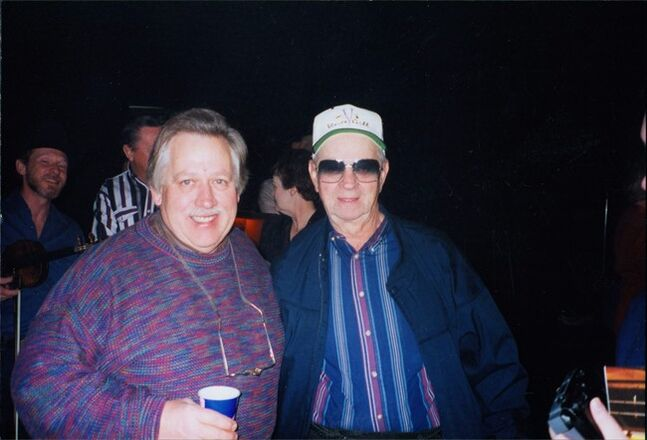 In this undated photo provided by Lindy McKim, country music singer John Conlee, left, poses with fan Paul Eckhart at the Opry House, in Nashville, Tenn. Eckhart, 83, is a loyal Grand Ole Opry fan: He has not missed a weekend performance in 42 years. (AP Photo/Lindy McKim)