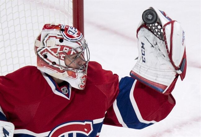 Montreal Canadiens goalie Carey Price makes a glove save on Tuesday, January 28, 2014 in Montreal. THE CANADIAN PRESS/Paul Chiasson