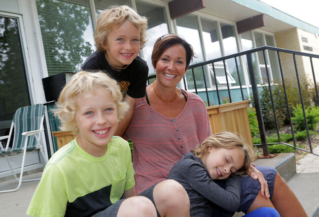 Kerri Lynn Gudz, a member of the newly resurrected Canadian Parents for French Brandon Chapter, and her children — Karlyn, Mitchell, centre, and Jackson — at École Harrison. An English-speaking family at home, Gudz wants the school to offer something different.