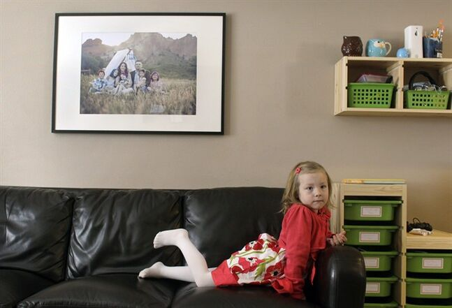 Coy Mathis sits on a couch at her home in Fountain, Colo., Monday Feb. 25, 2013. Coy has been diagnosed with Gender Identity Disorder. Biologically, Coy, 6, is a boy, but to his parents, three sisters and brother, family members and the world, Coy is a transgender girl. Ideas about gender-disorders began to develop in the 1950s, and have been evolving ever since, both within the medical community, and in American society. (AP Photo/Brennan Linsley)