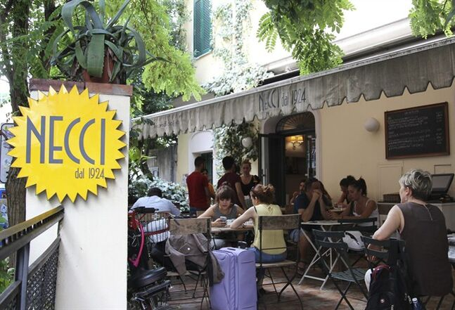 In this Aug. 1, 2014 photo, customers sit at outdoor seating at Necci bar, a bohemian outpost in Rome's edgy Pigneto neighborhood. Rome is a sightseer's dream, and for many visitors indulging in authentic Italian cuisine is one of the biggest draws. (AP Photo/Kavitha Surana)