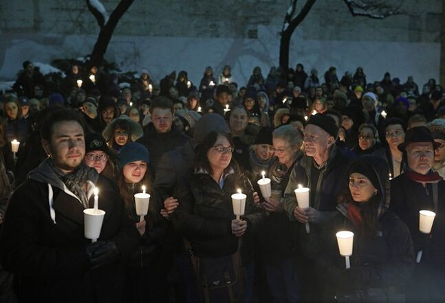 Hundreds of people gather for a candlelight vigil for actor Philip Seymour Hoffman in the courtyard of the Bank Street Theater, home of the Labyrinth Theater Company, Wednesday, Feb. 5, 2014, in New York. Hoffman died Sunday of a suspected drug overdose. (AP Photo/Kathy Willens)