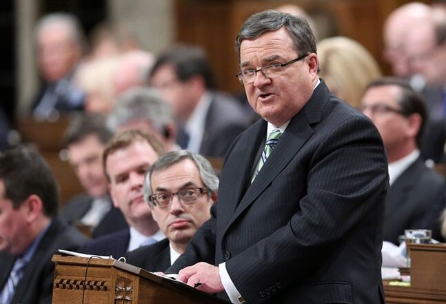 Minister of Finance Jim Flaherty tables the federal budget in the House of Commons on Parliament Hill in Ottawa on Tuesday, February 11, 2014. THE CANADIAN PRESS/Fred Chartrand