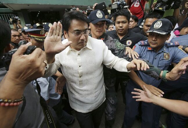 Philippine Senator Ramon Revilla Jr., a popular actor accused of receiving money in kickbacks, waves to reporters after attending his arraignment at the Sandiganbayan anti-graft court in suburban Quezon city, north of Manila, Philippines on Thursday, June 26, 2014. The court entered a not guilty plea for Revilla., an action movie star accused of receiving 224 million pesos ($5.1 million) in kickbacks from a scam that allegedly diverted millions of dollars from anti-poverty and development funds allotted to lawmakers' pet projects. (AP Photo/Aaron Favila)
