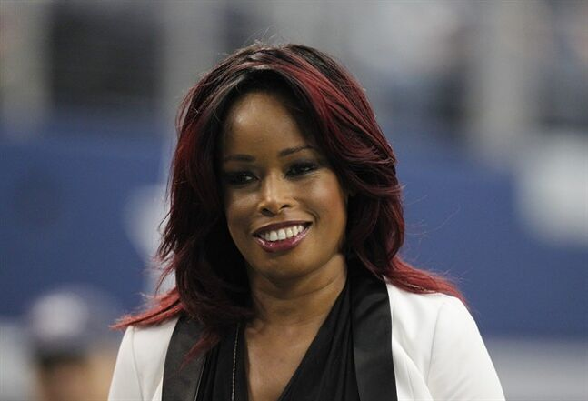 Sportscaster Pam Oliver stands on the sidelines during the second half of an NFL football game between the Dallas Cowboys and Tampa Bay Buccaneers in Arlington, Texas. Fox Sports says Pam Oliver is being