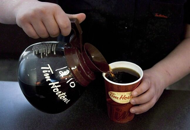 A cup of Tim Hortons coffee is poured in Toronto on May 14 2010. Burger King is in talks to buy Tim Hortons Inc. (TSX: THI) and form a new publicly listed company that would be based in Canada. THE CANADIAN PRESS/Chris Young