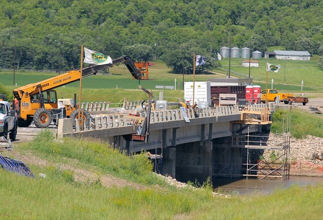 Construction work was underway on the bridge over the Assiniboine River on the TransCanada Highway near Grand Valley Road, in June. But high water on the river has forced the work's suspension.