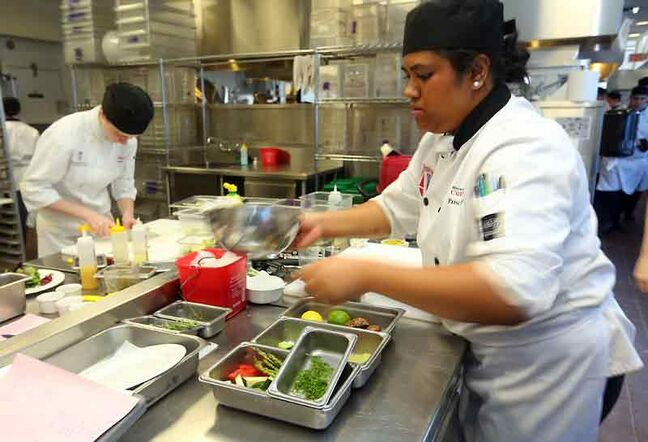 Pesila Aropio works in the preparation area during Monday's Black Box Competition at the Manitoba Culinary Arts School at Assiniboine Community College.