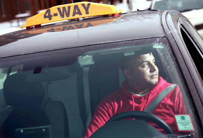 Jaswinder Singh sits in his cab near the Brandon hospital on Monday afternoon. The deaths of two Winnipeg patients in the past month has cast a spotlight on the health-care system's policies toward discharged patients and taxi use.