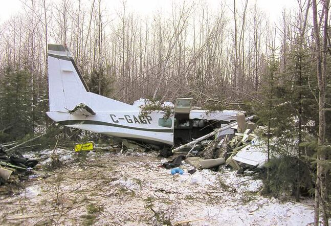 The wreckage of the Cessna 208 Caravan, which crashed into the bush near the Snow Lake airport Sunday. Pilot Mark Gogal was killed.
