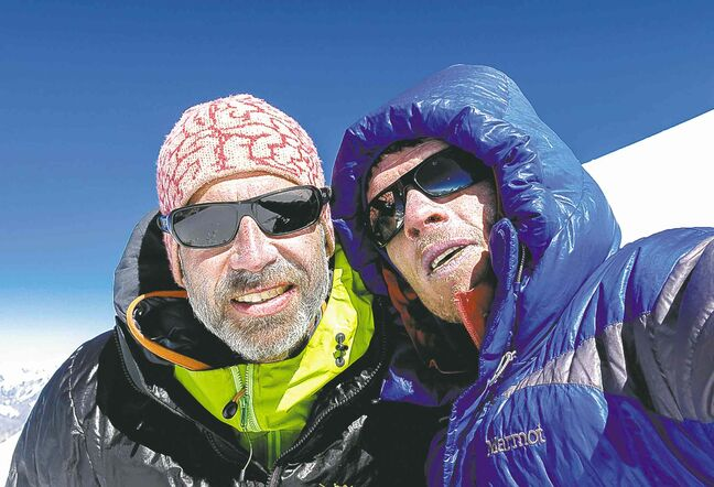 Former Brandon resident Ian Welsted (right) and his climbing partner Raphael Slawinski were the first to climb to the top of the western summit of K6 in Pakistan in June and have been nominated for a National Geographic award for the feat. In this photo, the two pose for a selfie at the mountain�s summit.