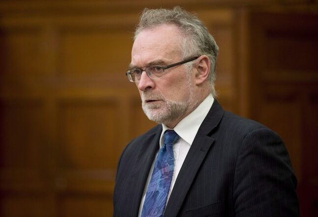 Auditor General Michael Ferguson waits to appear at committee in Ottawa on March 26, 2014. There's nothing like an auditor general's report to send federal cabinet ministers clamouring for the microphones. In the House of Commons today, Michael Ferguson will table his office's 2014 spring report, which is expected to touch on everything from prisons to public service pensions to First Nations policing. THE CANADIAN PRESS/Adrian Wyld