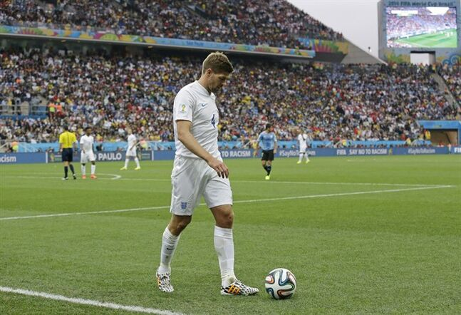England's Steven Gerrard walks back to take a corner during group D World Cup soccer action against Uruguay in Sao Paulo, Brazil, on June 19, 2014. Gerrard has announced his retirement from international football. THE CANADIAN PRESS/AP, Matt Dunham