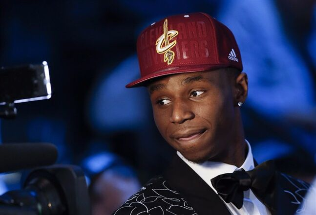 Andrew Wiggins of Kansas stops for a television interview after being selected by the Cleveland Cavaliers as the number one pick in the 2014 NBA draft, Thursday, June 26, 2014, in New York. Wiggins will wear Adidas with the Cleveland Cavaliers.The No. 1 overall pick in the draft, Wiggins wore the apparel company's gear while starring last season for Kansas. THE CANADIAN PRESS/AP Photo/Kathy Willens