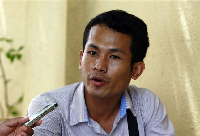 In this July 28, 2014, photo, Chhin Hun, 23, a student of design and architecture, learned about the Khmer Rouge from his parents and at school.
