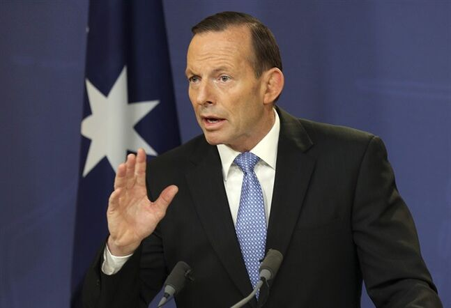 FILE - Australia's Prime Minister Tony Abbott speaks during a news conference in Sydney, Australia, in this July 19, 2014 file photo. Abbott said on Wednesday July 23, 2014 he was discussing with government leaders options for securing the 50-square kilometer (20-square mile) crash site, including his preferred option of a multinational security force mounted by countries such as Australia, Netherlands and Malaysia that lost citizens in the disaster. (AP Photo/Rob Griffith, File)
