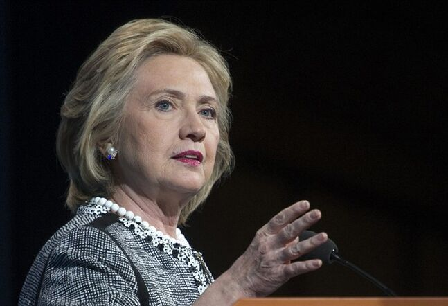 FILE - This May 14, 2014 file photo shows former Secretary of State Hillary Rodham Clinton speaking in Washington. Clinton defended her response to the deadly 2012 terrorist attack in Benghazi, Libya, writing in her new book that she will