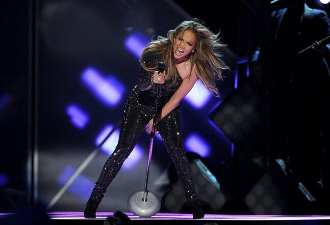 FILE - In this May 18, 2014 file photo, Jennifer Lopez performs on stage at the Billboard Music Awards at the MGM Grand Garden Arena. FIFA officials say on Sunday, June 8, 2014 Jennifer Lopez won't be performing the World Cup song along with co-artists Pitbull and Claudia Leitte in the opening ceremony of the 2014 World Cup on Thursday. (Photo by Chris Pizzello/Invision/AP, File)