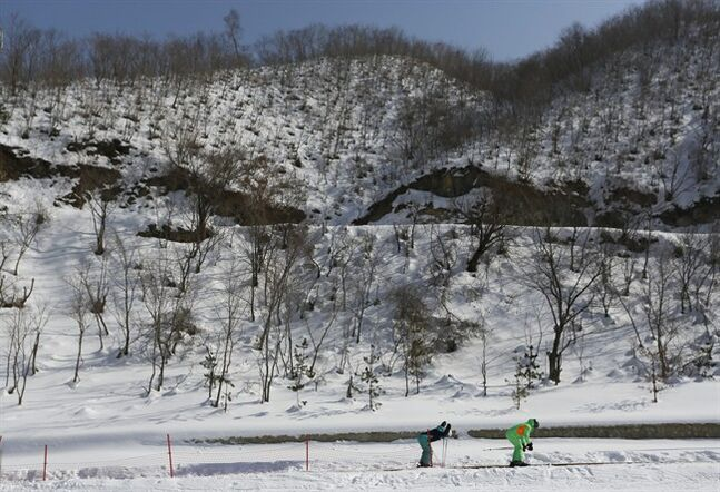 In this Feb. 22, 2014 photo, North Korean skiers move on a conveyor belt at Masik Pass ski resort in North Korea's Masik Pass. North Korea's newest symbol of national pride and