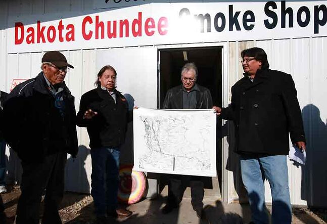 Elder Albert Taylor of Sioux Valley First Nation, Chief Frank Brown of the Canupawakpa Dakota First Nation, Chief Orville Smoke of the Dakota Plains First Nation and Coun. Craig 	Blacksmith of the Dakota Plains First Nation take part in the grand opening of the Dakota Chundee Smoke Shop on Highway 2 east of Pipestone in November 2011.