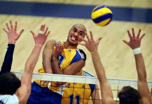 Brandon University Bobcats import left side hitter Sam Tuivai hammers a kill in Canada West conference action earlier this season.