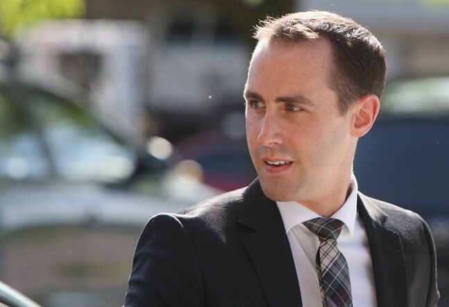 Defendant Michael Sona walks to the courthouse in Guelph, ON, Wednesday, June 4, 2014, the the Robocalls trial. THE CANADIAN PRESS/Dave Chidley