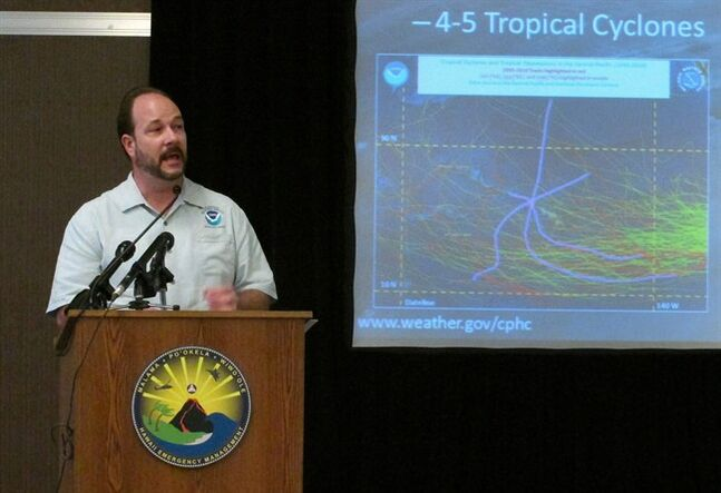 Acting Director Tom Evans of the Central Pacific Hurricane Center speaks during a briefing in Honolulu on Wednesday, May 21, 2014. Weather forecasters are predicting four to seven tropical cyclones in the central Pacific Ocean during this year's hurricane season. (AP Photo/Oskar Garcia)