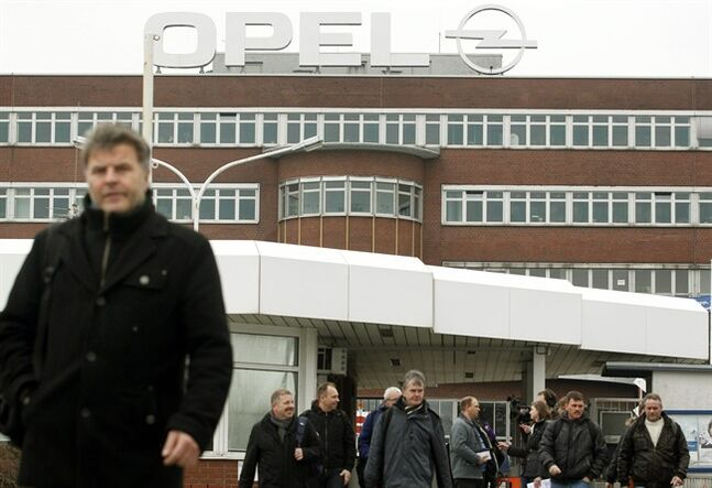 Opel employees leave the factory in Bochum,�Germany, Thursday, Feb. 28, 2013. Cars will still be manufactured at the Opel Factory until at least 2016 as part of a grace period. Opel said Thursday Bochum can keep producing cars until the current Zafira model is phased out at the end of 2016. Starting in the second quarter, it plans to cut one of three daily shifts there. (AP Photo/dpa, Roland Weihrauch)