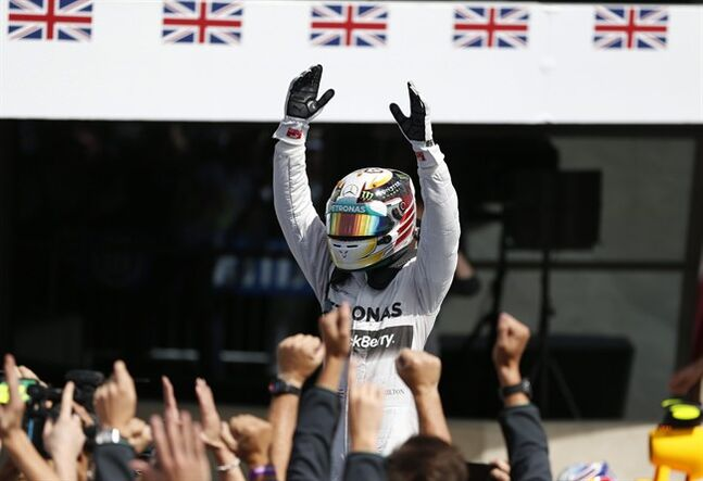 Britain's Lewis Hamilton of Mercedes celebrates after winning the British Formula One Grand Prix at Silverstone circuit, Silverstone, England, Sunday, July 6, 2014. Finland's Valtteri Bottas of Williams finished second, and Australia's Daniel Ricciardo of Red Bull finished third.(AP Photo/Lefteris Pitarakis)