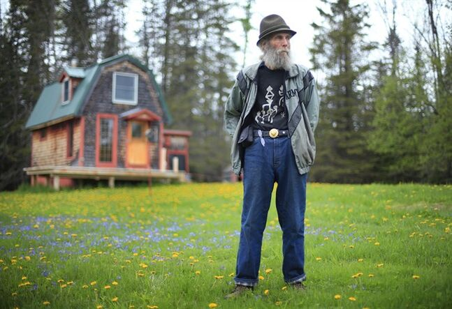 In this photo taken on Friday, May 23, 2014, Burt Shavitz stands on his property in Parkman, Maine. Shavitz, the Burt behind Burt's Bees, still lives in rural Maine after leaving the company that was later sold for millions by his former business partner, Roxanne Quimby. (AP Photo/Robert F. Bukaty)