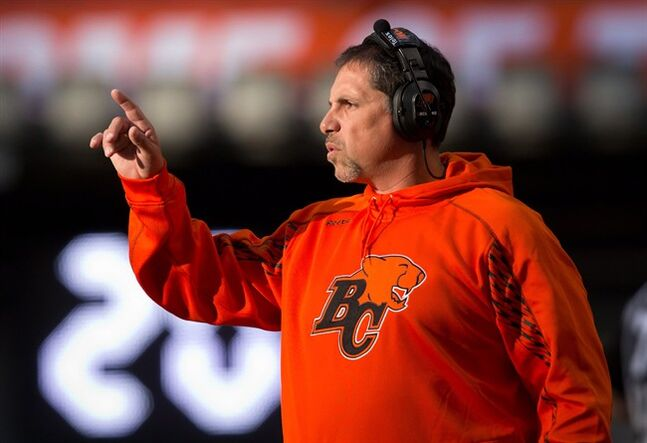 B.C. Lions' head coach Mike Benevides stands on the sideline during the first half of a pre-season CFL football game against the Calgary Stampeders in Vancouver, B.C., on Friday June 20, 2014. THE CANADIAN PRESS/Darryl Dyck