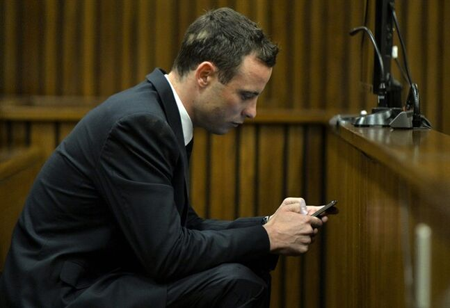 Oscar Pistorius sits in court during his ongoing murder trial in Pretoria, South Africa, Thursday, July 3, 2014. Pistorius is charged with the 2013 Valentine's Day shooting death of his girlfriend Reeva Steenkamp. (AP Photo/Herman Verwey, Pool)