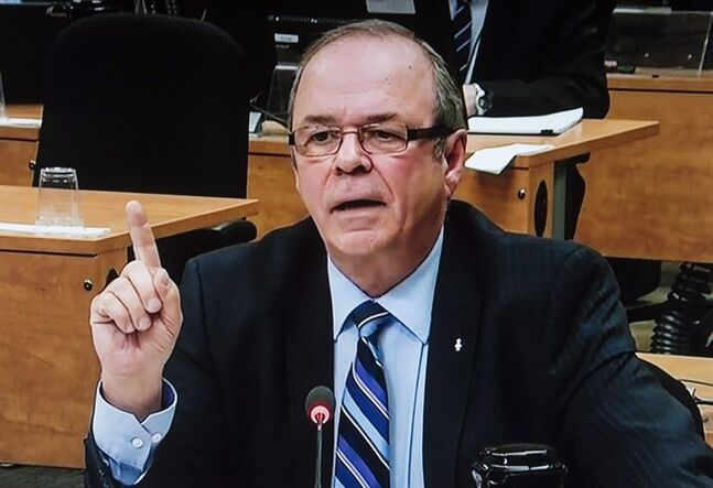 Former FTQ president Michel Arsenault is seen on a photograph taken off a television monitor at the Charbonneau inquiry looking into corruption in the Quebec construction industry Wednesday, January 29, 2014 in Montreal. THE CANADIAN PRESS/The Charbonneau Commission